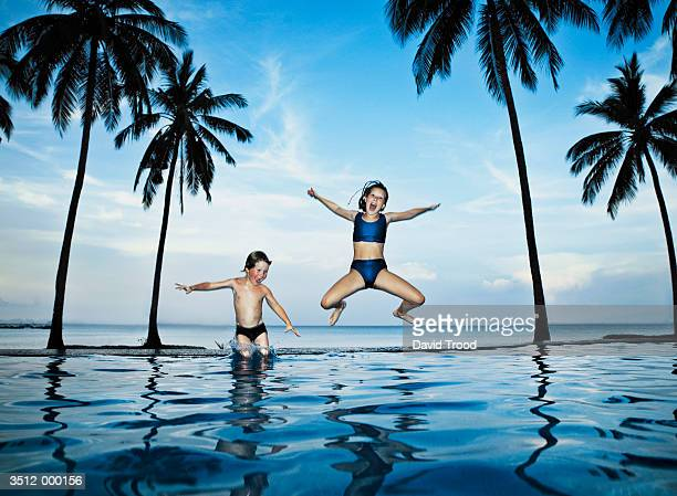 children jumping into pool - very young thai girls stock photos and pictures
