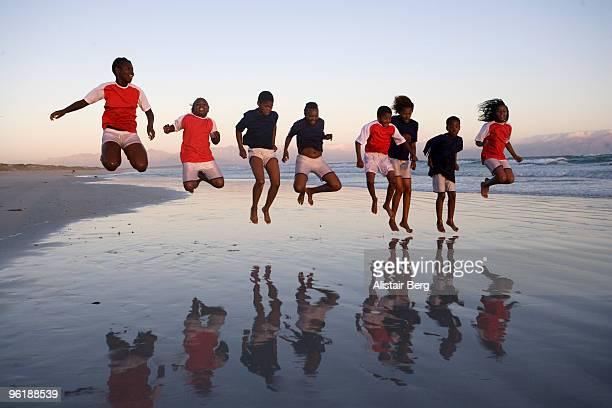 Children jumping on a beach