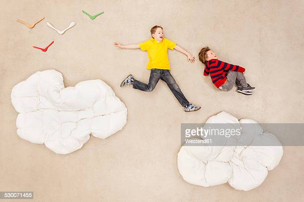 Children jumping over clouds