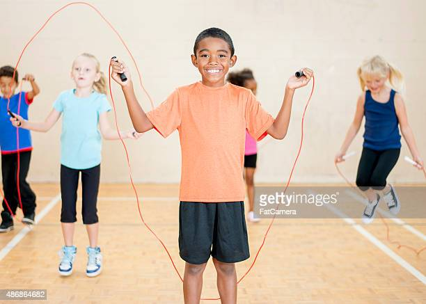 children jumping rope at school - pe teacher stock photos and pictures