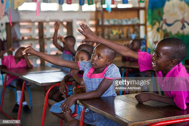 Children K3 that attend the kindergarten school learn to read and write English during lessons at the Wema Centre Mombassa Kenya Wema is a NGO...