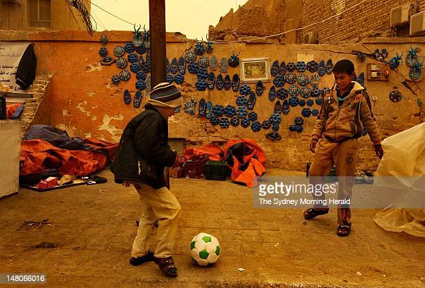 Children kick a soccer ball on a street near the Imam Ali Shrine on February 12,2012 in Najaf, Iraq. After Mecca and Medina, Najaf is the third...
