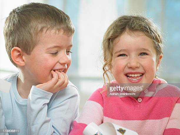 Children laughing together indoors