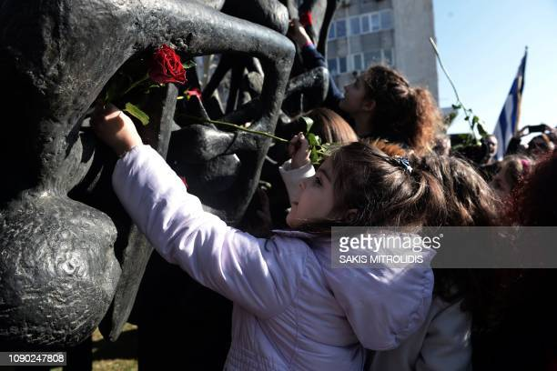 Children lay roses at the Holocaust Memorial in Thessaloniki on January 27 during the International Holocaust Remembrance Day which commemorates the...