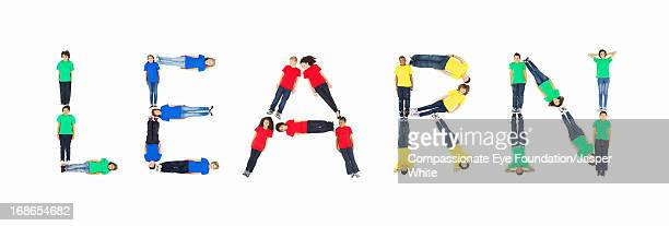 Children laying in 'LEARN' formation