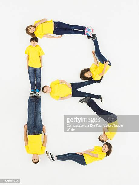 Children laying in letter 'B' formation