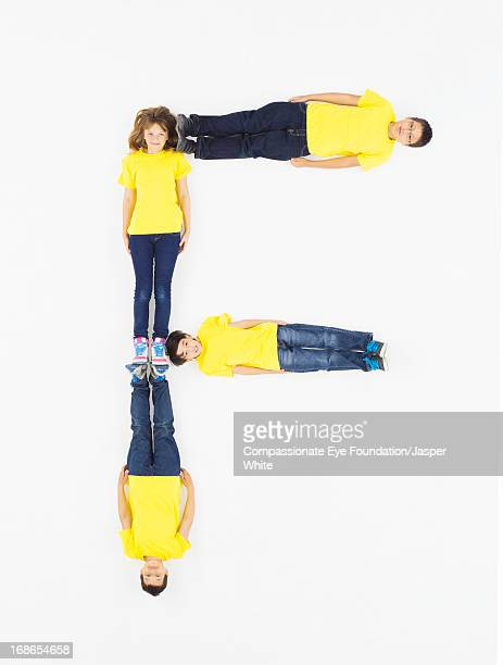 Children laying in letter 'F' formation