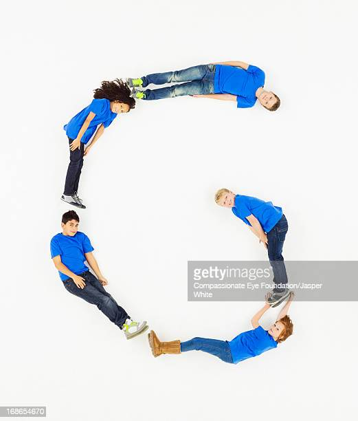 Children laying in letter 'G' formation