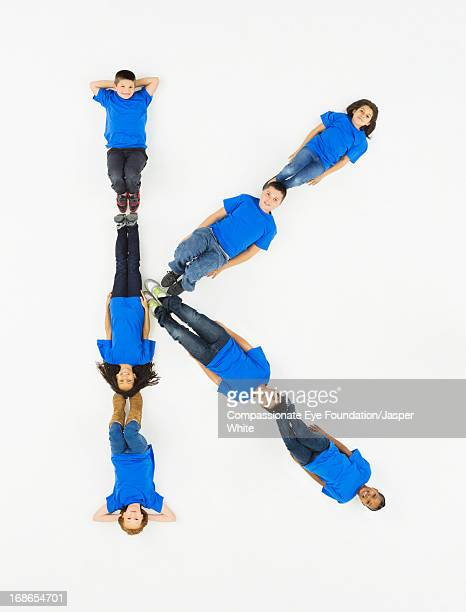 Children laying in letter 'K' formation
