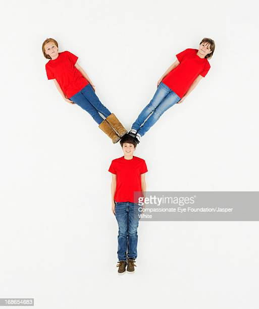 Children laying in letter 'Y' formation