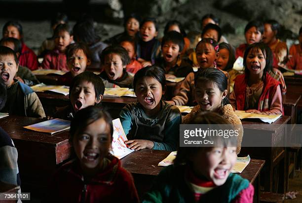 Children learn a song in music class at their school in a huge cave at a remote Miao village March 16 2007 in Ziyun county Guizhou province of...