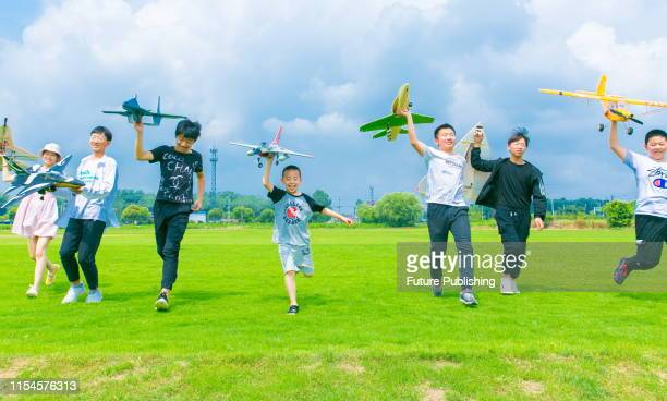Children learn how to assemble model airplanes and operate drones during a technology training class in rugao, jiangsu province, China, July 8, 2019....