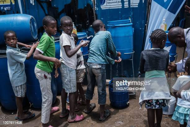 Children learn how to wash hands for prevention of the COVID-19 as local NGO Shining Hope for Communities installs hand washing stations at Kibera...