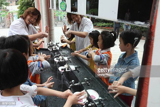 Children learn how to wash their hands during an H1N1 prevention education activity at Hehuachi Kindergarten on May 21 2009 in Shanghai China The...