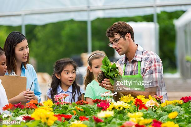 Children learning about flowers