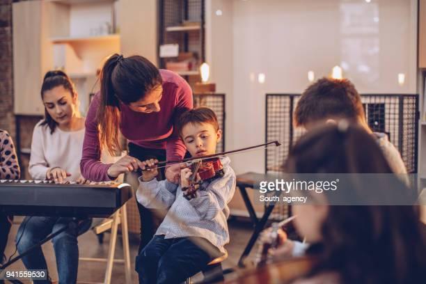 Children learning in music school