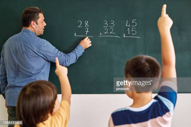children learning mathematic at classroom on school building. education - blackboard visual aid stock pictures, royalty-free photos & images