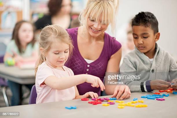 Children Learning The Letter of the Alphabet