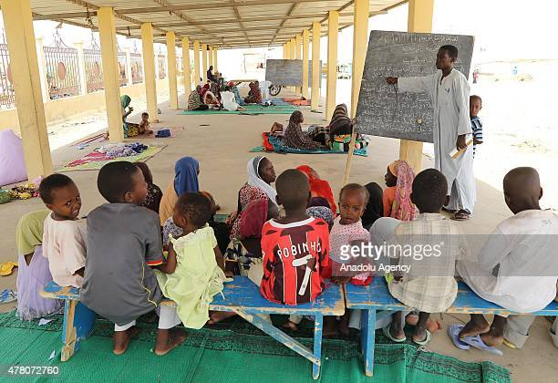 N'DJAMENA CHAD JUNE 21 Children learning the Quran at a camp near the capital N'Djamena Chad on June 21 2015