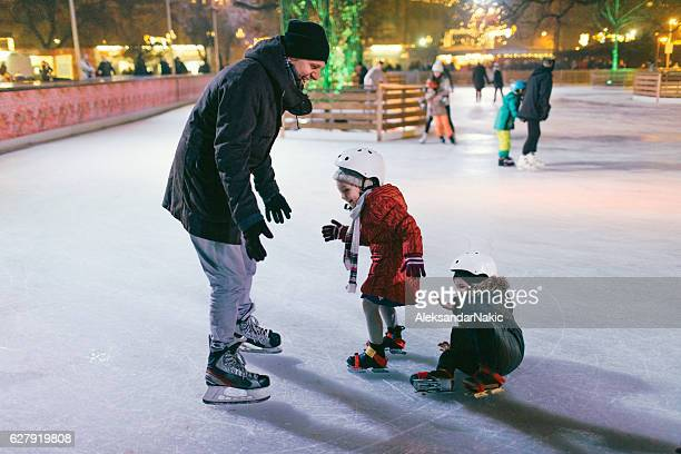 children learning to ice-skate - skating stock pictures, royalty-free photos & images