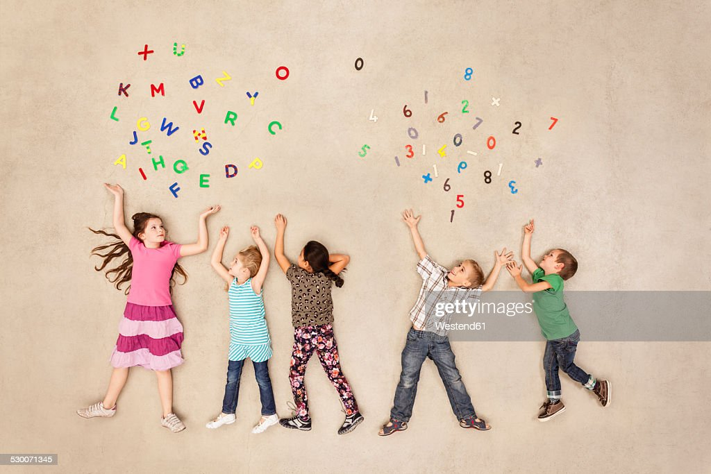Children learning to read and calculate : Stock Photo