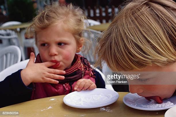 Children Licking Powdered Sugar off Saucers