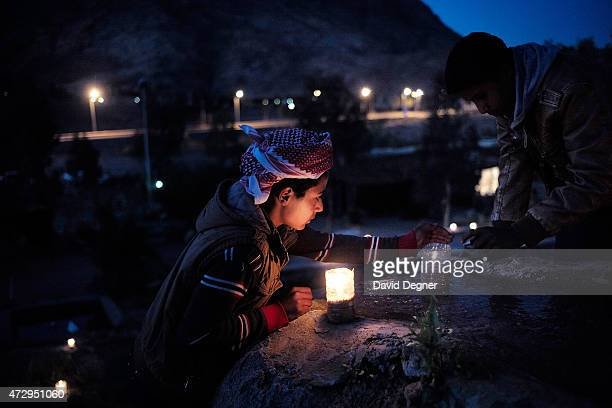 Children light candles around the Fox Camp hotel for tourists who have come to hike through the mountains of South Sinai on April 16 2015 near St...