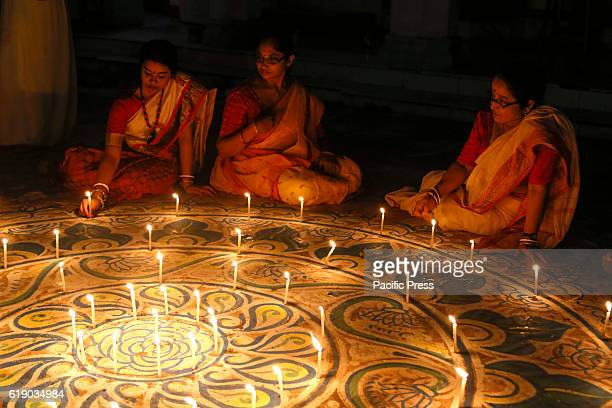 Children light candles during traditional Diwali Light Balloon Festival also called Phanushndia Fanush paper made hot air balloon was once the...
