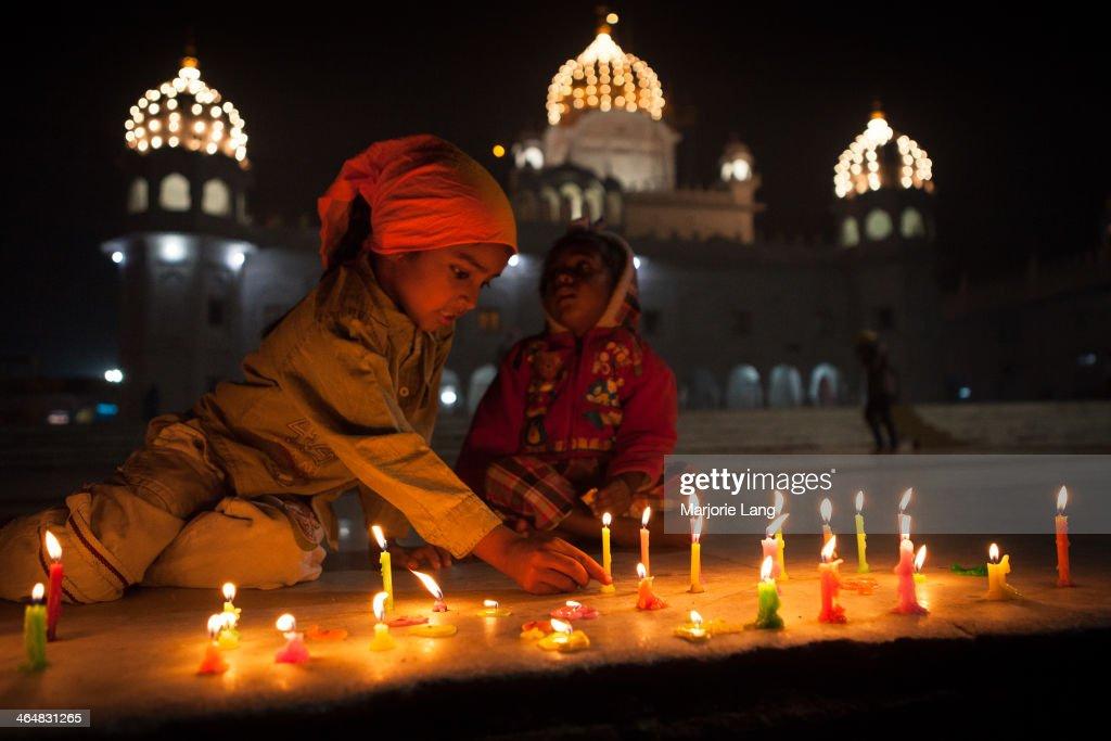 CONTENT] Children lighting candles during Diwali festival inside the Sikh Gurdwara Dukh Nivaran Sahib of & Children lighting candles by a Sikh temple Pictures | Getty Images azcodes.com