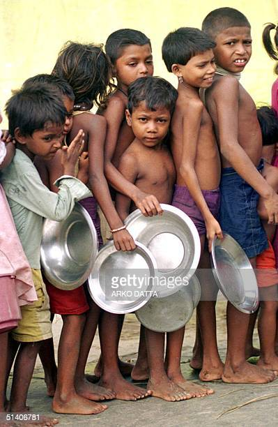 Children line up to get their share of khichidi as the Indian army distributes relief food 12 September to those stranded in the higher areas of...