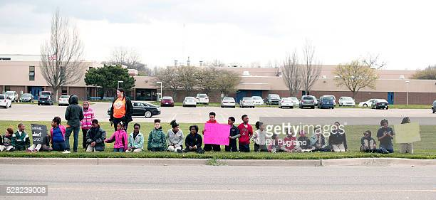 Children line up to greet President Obama's motorcade before he speaks at Northwest High School about the Flint water contamination crises May 4 2016...