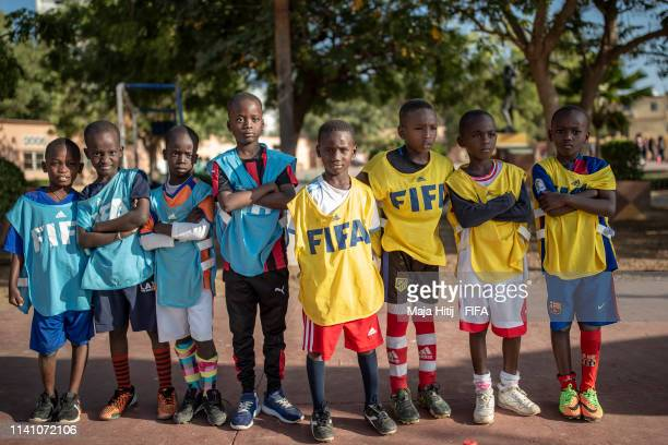 Children line up to play football during a FIFA Grassroots schools program on January 18 2019 in Dakar Senegal