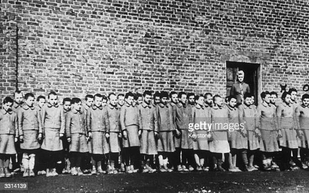 Children lined up at a labour camp near Lodz in Poland
