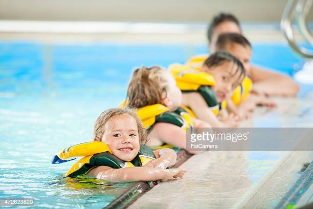Children Lined up at Edge of Pool