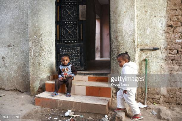 Children linger outside the home in the suburbs of Faiyum Egypt on Nov 30 where Mahmoud Shafiq who carried out a suicide bombing terrorist attack in...
