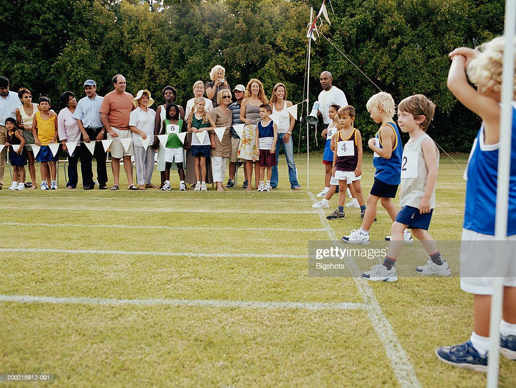 children lining up at starting line at school sports day ストック