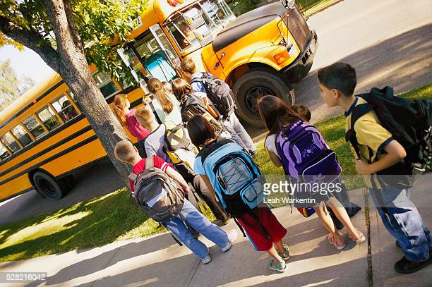 Children Lining Up for School Bus