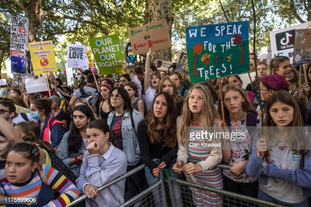 Children listen to speakers as they attend the Global Climate Strike on September 20 2019 in London England Millions of people are taking to the...