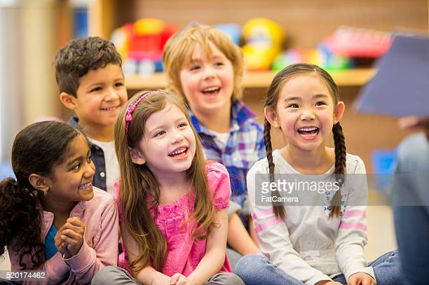 children listening to a story - school children stock pictures, royalty-free photos & images