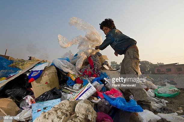 Children live play and work on the garbage dump at Bhagmati River in the middle of the city The garbage collected off the streets of the capital city...