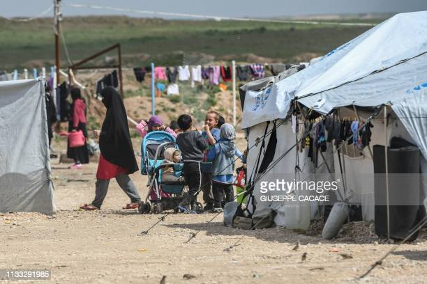 Children living in alHol camp which houses relatives of Islamic State group members gather in the camp in alHasakeh governorate in northeastern Syria...