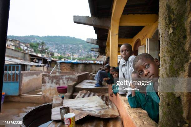 Children living in Bomeh Village on June 15, 2021 in Freetown, Sierra Leone. The poorest of the poor have started to settle on the waste mountains of...