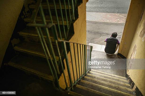 Children loiter around a stairwell on the Falinge Estate which has been surveyed as one the most deprived areas in England for five years in a row on...