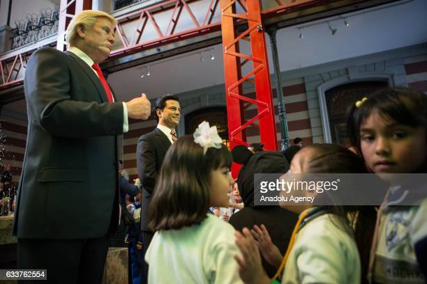 Children look a wax sculpture of US President Donald Trump and Mexican President Enrique Pena Nieto at the Wax Museum in Mexico City Mexico on...