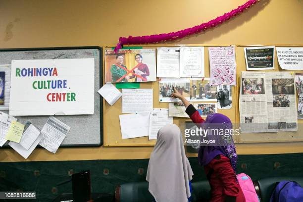 Children look at a bulletin board at the Rohingya Cultural Center of Chicago on January 10 2019 in Chicago Illinois Chicago has one of the largest...