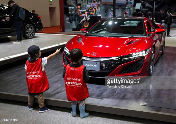 Children look at a Honda Motor Co NSX vehicle during the Tokyo Motor Show at Tokyo Big Sight on October 25 2017 in Tokyo Japan The 45th edition of...