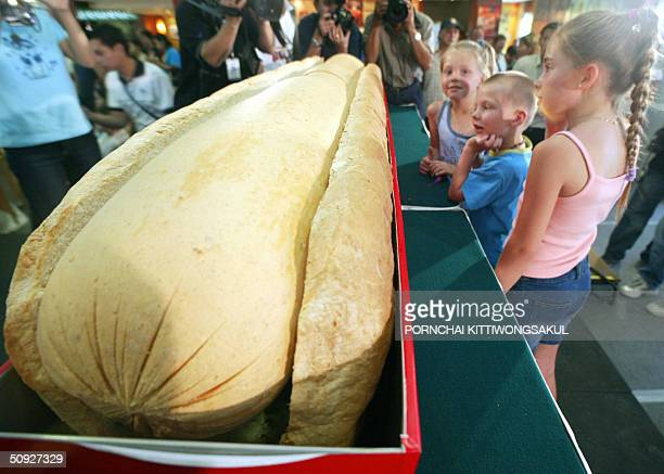 Children look at the biggest hotdog in Thailand during the opening of the 3rd annual Thailand Hot Dog Eating Championship at Ripley's Museum in...