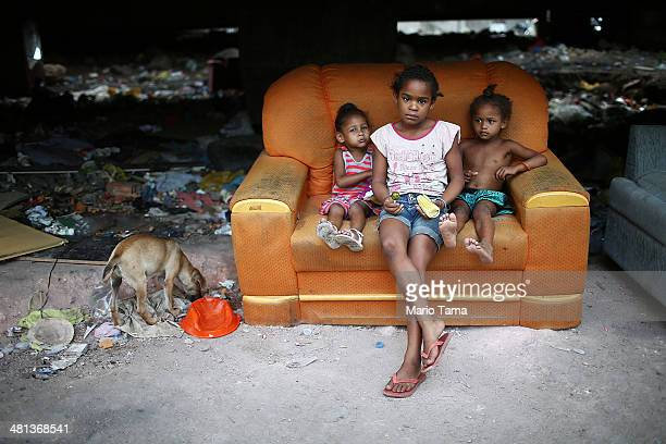 Children look at the camera in an impoverished area in the unpacified Complexo da Mare slum complex one of the largest 'favela' complexes in Rio on...