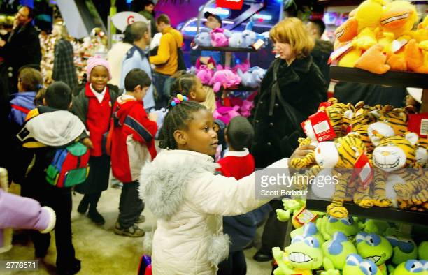 Children look at toys inside of Hamley's Toy Store December 2 2003 in London England A survey has found that a third of British Christmas shoppers...