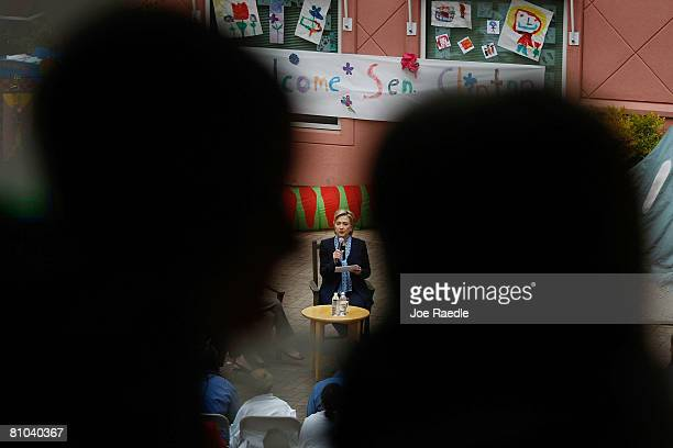 Children look on as Democratic presidential hopeful U.S. Senator Hillary Clinton speaks during a round table discussion on health care at Doernbecher...